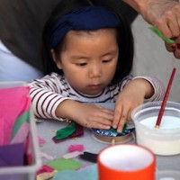 Child making arts and crafts