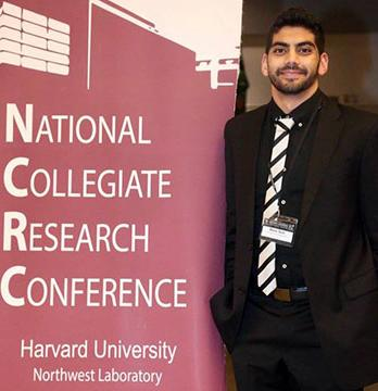 Oxy student Mark Gad at the national collegiate research conference