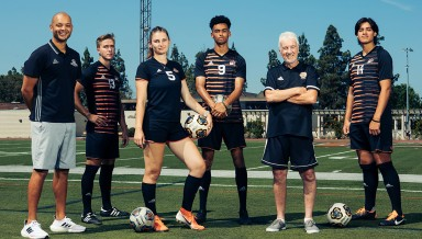 Oxy soccer players posing on field