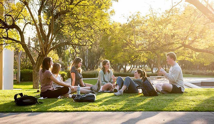 Oxy students sitting on the campus lawn
