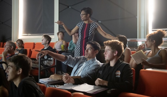 Students in a classroom with a professor lecturing