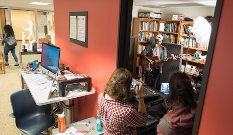 Students watch musicians performing in the Critical Making Studio