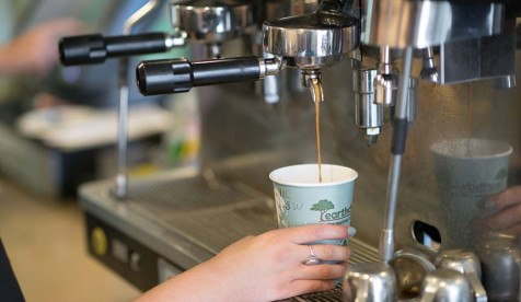 A barista pours an espresso drink at the student-run Green Bean