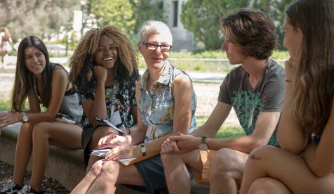 Professor Gretchen North and students talking together