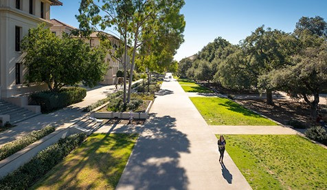 An overhead shot of a lone figure walking across the Academic Quad