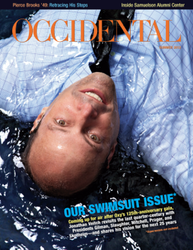 President Jonathan Veitch in a pool of water. Cover story: Our Swimsuit Issue