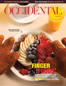 A plate of berries and bananas on top of a waffle dusted with powdered sugar. Cover story: Finger Foods