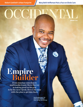 A man in a blue suit smiling brightly. Cover story: Empire Builder