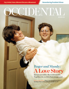 An old photo of a groom carrying his bride across a threshold. Cover story: Roger and Mandy: A Love Story