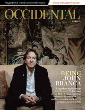 A man sits pensively on a couch. Cover story: Being John Branca