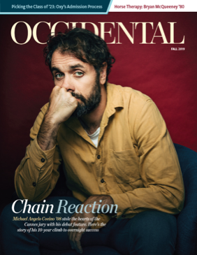 A man sits resting his chin on his hand looking pensive. Cover story: Chain Reaction