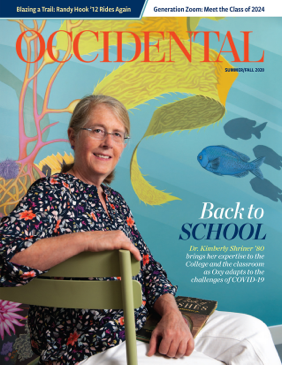 A woman sits in front of a colorful mural. Cover story: Back to School