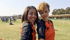 Two Oxy students on the rugby team pose together
