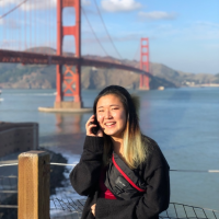 Hyun Gill in front of the Golden Gate Bridge