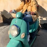 Naya Ramtahal sitting on a motorized scooter