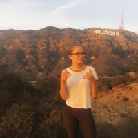 Olivia Oosterhout standing in fron tof the Hollywood sign
