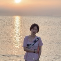 Sherry Gao in front of a sunset