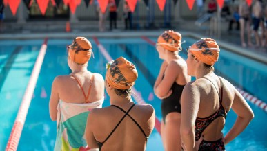 Oxy swimmers standing near the pool