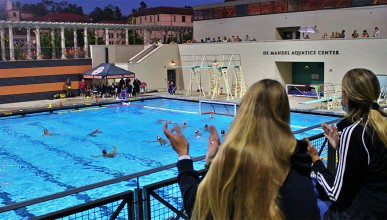 students cheering at a water polo game at the DeMandel pool
